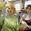 Rob Winner –  rwinner@daily-chronicle.com<br /> Recently at Express Yourself in DeKalb, owner and nurse Judy Bergsmith (left) shows new mother Suzi Leigh products that will help her nurse newborn Jacob. Express Yourself is a new downtown boutique in DeKalb that specializes in newborn and nursing mother needs.<br /> 09/17/2009