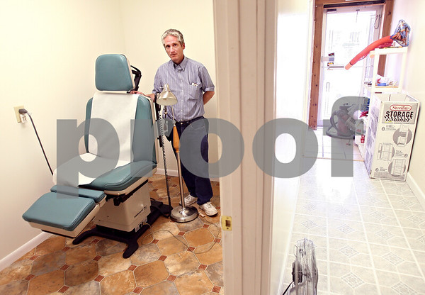 """Beck Diefenbach  -  bdiefenbach@daily-chronicle.com<br /> <br /> Out on a Whim owner Ken Weinstock had to bring his piercing rooms up to """"tattoo standards,"""" but is not allowed to offer tattoo services in his shop in DeKalb, Ill., on Tuesday June 9, 2009. Kempa has"""