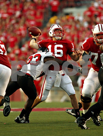 Beck Diefenbach – bdiefenbach@daily-chronicle.com<br /> <br /> Wisconsin quarterback Scott Tolzien (16) is nearly taken down by Northern Illinois Patrick George (33) during the first half of the game at University of Wisconsin in Madison, Wisc., on Saturday Sept. 5, 2009. Wisconsin beat Northern Illinois 28 to 20.