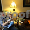 Beck Diefenbach  -  bdiefenbach@daily-chronicle.com<br /> <br /> Zach Sands holds his son Alexander, 4 months, before dinner at their Sycamore home on Thursday July 2, 2009. Zach is moving his family to Moldova on a Fulbright scholarship after recently graduating with a master's degree in english from Northern Illinois University.