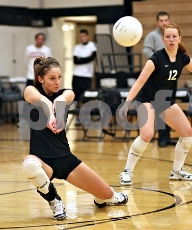 Beck Diefenbach – bdiefenbach@daily-chronicle.com<br /> <br /> Kaneland's Abby VanDerJeyden (CQ) (4) returns the ball during the second period of the game against DeKalb High School at Kaneland High School in Maple Park, Ill., on Saturday Sept. 19, 2009.