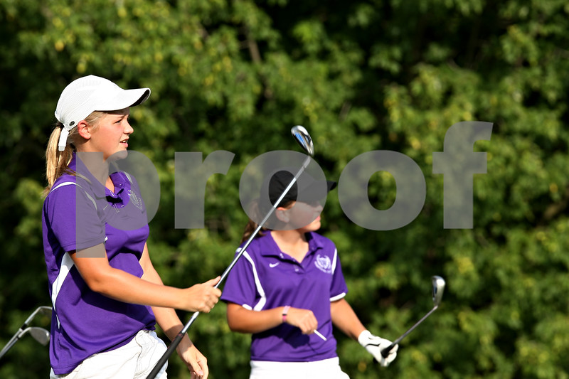 Beck Diefenbach  -  bdiefenbach@daily-chronicle.com<br /> <br /> Hampshire's Connie (left) and Taylor Ellett watch Connie's drive during their match against Genoa-Kingston High school at Oak Club of Genoa in Genoa, Ill., on Wednesday Sept. 23, 2009.