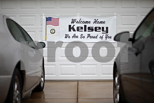Beck Diefenbach  -  bdiefenbach@daily-chronicle.com<br /> <br /> A sign welcoming home Kelsey Hitzeroth hangs on the garage of her family's Sycamore, Ill., home on Friday Aug. 28, 2009.