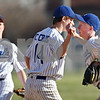 Beck Diefenbach  -  bdiefenbach@daily-chronicle.com<br /> <br /> Hinckley-Big rock's Jake Dunteman, right, celebrates with pitcher Colton Craig (14) after ending the top of the third inning with a diving catch against Newark High School in Big Rock, Ill., on Thursday April 16, 2009.