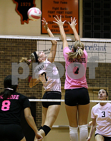 Rob Winner –  rwinner@daily-chronicle.com<br /> DeKalb's Rachel Raynor (left) tries to tip one over the net as Sycamore's Brittany Huber goes up to block.<br /> 09/22/2009