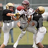Beck Diefenbach  -  bdiefenbach@daily-chronicle.com<br /> <br /> Sycamore defensive backs Eric Ray (5, left) and Marckie Hayes (1, right) break up a pass intended for Montini wide receiver Jordan Westerkamp (81) during the second quarter of the playoff game at Sycamore High School in Sycamore, Ill., on Saturday Nov. 14, 2009.