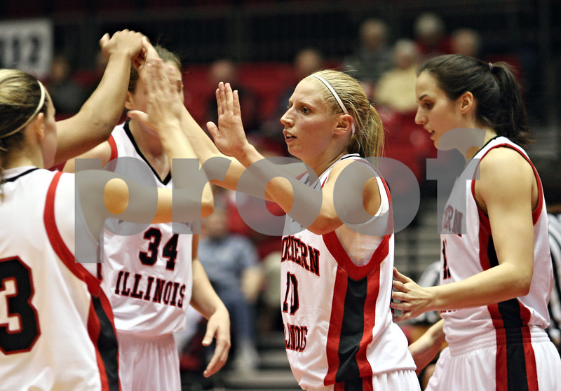 Beck Diefenbach  -  bdiefenbach@daily-chronicle.com<br /> <br /> Northern Illinois guard Jessie Wilcox (12) celebrates with teammates after she is fouled during the first half of the game against Ball State at the NIU Convocation Center in DeKalb, Ill., on Wednesday Jan. 21, 2009.