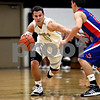 Rob Winner – rwinner@daily-chronicle.com<br /> Rob Winner – rwinner@kcchronicle.com<br /> Kaneland's Ryley Bailey moves the ball past Glenbard South defender Michael Rovansek during the first half.<br /> 12/01/2009