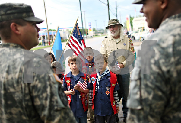 Beck Diefenbach  -  bdiefenbach@daily-chronicle.com<br /> <br /> Pack 118 scouts Sam Hancock ,9, center left, and Jacob Giles ,7, ask questions about the war in Afghanistan to Specialist Eugene Van Heeran, left, and Private First Class Anthony Morrison before the return of the Sycamore National Guard Unit in Sycamore, Ill., on Monday June 1, 2009.