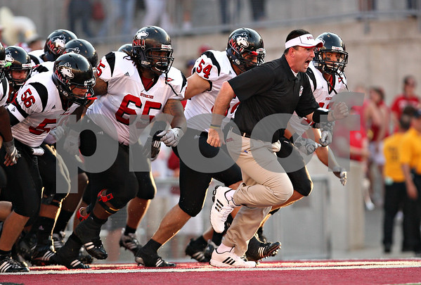 Beck Diefenbach – bdiefenbach@daily-chronicle.com<br /> <br /> The Northern Illinois University Football team enters the field before the start of the game against University of Wisconsin in Madison, Wisc., on Saturday Sept. 5, 2009.