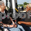 Beck Diefenbach  -  bdiefenbach@daily-chronicle.com<br /> <br /> Voluntary Action Center bus driver Larry Weaver, right, helps Lois Huffaker, of Sycamore, get on the free bus which will take her home following her dialysis treatment at Divita Dialysis in Sycamore, Ill., on Monday June 22, 2009. The United Way financially supports the VAC.