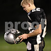 Beck Diefenbach  -  bdiefenbach@daily-chronicle.com<br /> <br /> Kaneland's Quinn Buschbacher (22) reacts after losing to Sycamore in the class 5A playoff game at Kaneland High School in Maple Park, Ill., on Saturday Oct. 31, 2009.