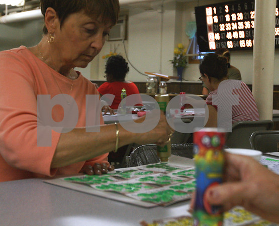 Randi Stella – rstella@daily-chronicle.com<br /> <br /> Carol Niles, 66, marks a bingo during Bingo Night at St. Mary's school in DeKalb, Ill., Monday, June 6th, 2009.