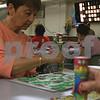 Randi Stella – rstella@daily-chronicle.com<br /> <br /> Carol Niles, 66, marks a bingo during Bingo Night at St. Mary's school in DeKalb, Ill., Monday, June 6th, 2009.
