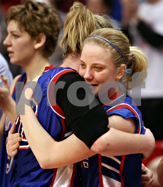 Beck Diefenbach – bdiefenbach@daily-chronicle.com<br /> <br /> Hinckley-Big Rock's Jes Meyer, right, and Jenna Thorp  embrace seconds before defeating Winchester West Central in the Class 1A State Championship at the Redbird Arena in Normal, Ill., on Saturday Feb. 28, 2009.