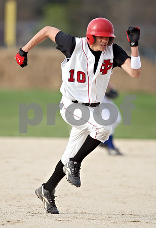 Beck Diefenbach  -  bdiefenbach@daily-chronicle.com<br /> <br /> Indian Creek's Trevor Foster (10) steals third base during the fourth inning of the game against Hinckley-Big Rock at Indian Creek in Shabbona, Ill., on Monday May 4, 2009.