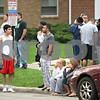 Beck Diefenbach  -  bdiefenbach@daily-chronicle.com<br /> <br /> Residents and neighbors watch as firefighters battle a fire which damaged the Omega Delta Fraternity house on the 800 block of Hillcrest Road in DeKalb, Ill.