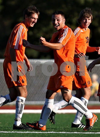 Beck Diefenbach    bdiefenbach@daily-chronicle.com<br /> DeKalb's Eric Galvan (10, center) celebrates his goal during the first half of the game against Sycamore High School at the Northern Illinois University Soccer and Track and Field Complex in DeKalb, Ill., on Monday Sept. 5, 2009.