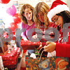Beck Diefenbach  -  bdiefenbach@daily-chronicle.com<br /> <br /> (From right) Maria Morrow, Keri Pollock, and Rhonda Morrow look through Christmas presents to give to kids at the community dinner at Flippin Eggs in DeKalb, Ill., on Wednesday Dec. 23, 2009.