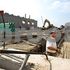 Beck Diefenbach  -  bdiefenbach@daily-chronicle.com<br /> <br /> Construction workers build the southeast  corner to the new DeKalb High School on Dresser Road in DeKalb, Ill., on Tuesday Sept. 8. 2009.