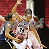 Beck Diefenbach  -  bdiefenbach@daily-chronicle.com<br /> <br /> Northern Illinois guard Sarah Rogers (24) is knocked over by Akron guard Amber Witt (12) during the first half of the game at Northern Illinois' Convocation Center in DeKalb, Ill., on Wednesday Feb. 4, 2009.