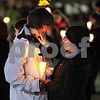 Beck Diefenbach  -  bdiefenbach@daily-chronicle.com<br /> <br /> Northern Illinois University student Jen Walkers, right, wipes the tears of fellow student Chris Dertz following the candle light vigil on the Martin Luther ing Jr. Commons on the campus of Northern Illinois University in DeKalb, Ill., on Saturday Feb. 14, 2009.