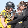 Beck Diefenbach  -  bdiefenbach@daily-chronicle.com<br /> <br /> Sycamore head coach Jill Carpenter tends to pitcher Rhianna Fleetwood (11) after being hit by a pitch in the hand during the top of the fourth inning of the  Class 3A Rochelle Sectional semi-final game against Burlington Central at Rochelle High School in Rochelle, Ill., on Wednesday June 3, 2009.