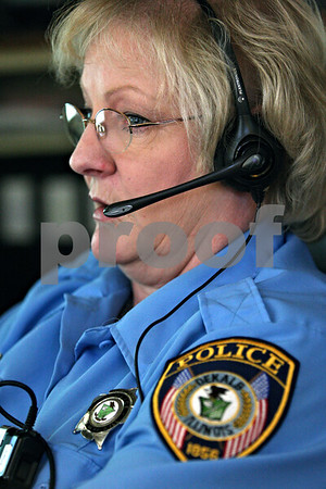 Rob Winner – rwinner@daily-chronicle.com<br /> Carol Halsey, who works within the telecommunications center at the DeKalb Police Department, fields a call on Monday October 26, 2009.