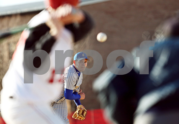Beck Diefenbach  -  bdiefenbach@daily-chronicle.com<br /> <br /> Somonauk pitcher Aaron Alvarez (6) watches his pitch during the bottom of the fourth inning against Indian Creek at Indian Creek High School in Shabbona, Ill., on Friday April 3, 2009.