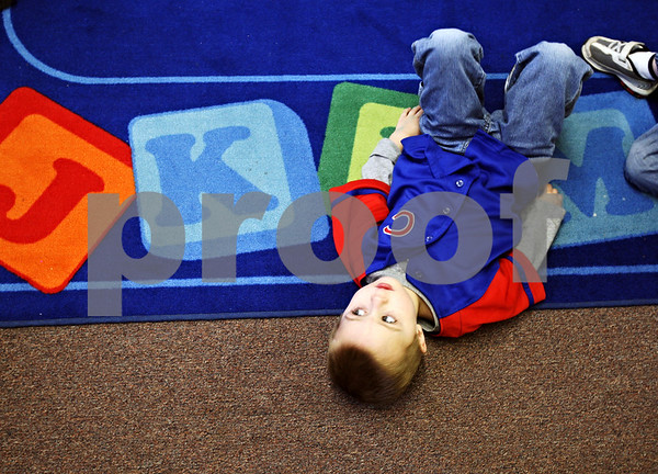 Beck Diefenbach  -  bdiefenbach@daily-chronicle.com<br /> <br /> Drake Prestegard, 3, lays on the floor before being asked to sit up during preschool at United Church of Christ in Shabbona, Ill., on March 24, 2009. The church is hosting a fundraiser to replace the carpeted floor in the preschool with tile.