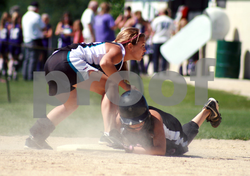 Randi Stella -  rstella@daily-chronicle.com<br /> <br /> Kishwaukee Valley Storm Haley Salaza (33) is tagged out by Sam Hansen (16) from the Aurora Raiders during a 16-under game during Storm Dayz in Sycamore, Ill., on Sunday June 28, 2009.