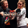 Beck Diefenbach  -  bdiefenbach@daily-chronicle.com<br /> <br /> Brett Hamilton, left, playing Herr Drosselmeyer, gives the iconic Nutcracker to his daughter Zoey, playing Clara, during rehearsal for The Nutcracker at the Egyptian Theater in DeKalb, Ill., on Wednesday Dec. 9, 2009.