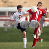 Beck Diefenbach  -  bdiefenbach@daily-chronicle.com<br /> <br /> Sycamore's Jon Pevonka (18, left) and Marmion's Max Rosenfelder (11) battle for the ball during the first half of the game at Sycamore High School in Sycamore, Ill., on Tuesday Sept. 15, 2009. Sycamore tied with Marmion 0-0.