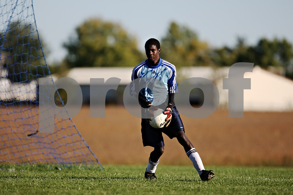 Rob Winner – rwinner@daily-chronicle.com<br /> <br /> Goalie Shaquille Crayton of Indian Creek controls a ball during Wednesday's match against Somonauk.<br /> <br /> 10/07/2009