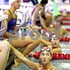 Beck Diefenbach  -  bdiefenbach@daily-chronicle.com<br /> <br /> Emily Waller, of the Kishwaukee YMCA and DeKalb County Swim Team, check her time during practice at the Kishwuakee YMCA in Sycamore, Ill., on Monday July 20, 2009.