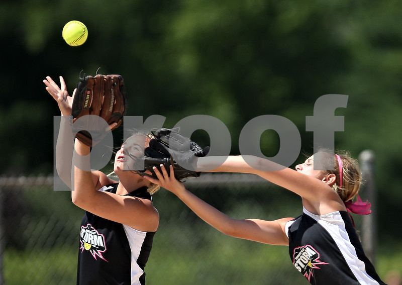 Beck Diefenbach  -  bdiefenbach@daily-chronicle.com<br /> <br /> Kishwaukee Valley Storm's Amy Clark (32) and Natalie Klein (83) each go for a pop-fly during a 14-under game against the Chicago Out Burst during Storm Dayz in Sycamore, Ill., on Sunday June 28, 2009.