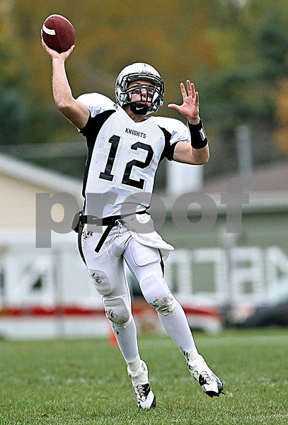 Rob Winner - rwinner@daily-chronicle.com<br /> <br /> Kaneland quarterback Joe Camiliere looks to throw a pass during the second quarter.<br /> <br /> 10/10/2009