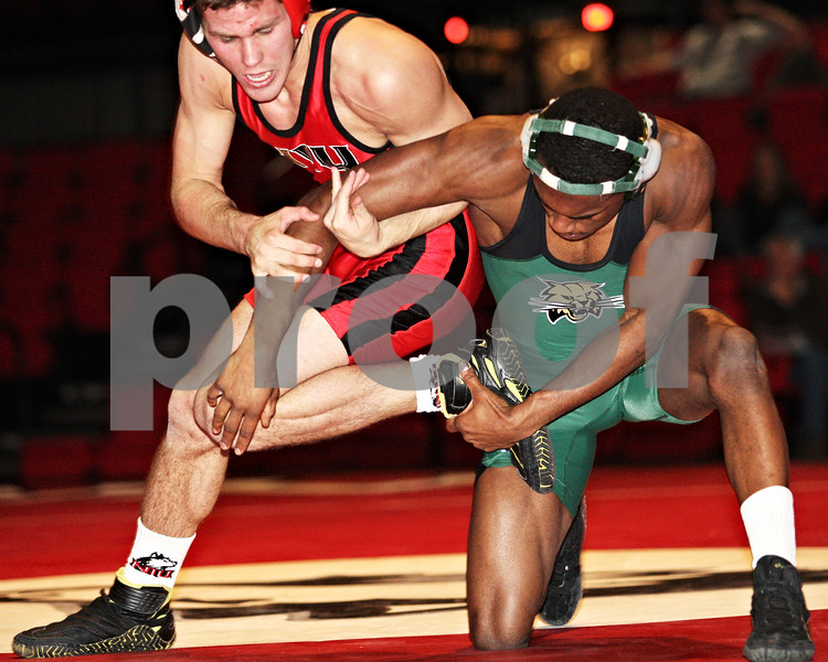 Beck Diefenbach  -  bdiefenbach@daily-chronicle.com<br /> <br /> Northern Illinois' Pat McLemore gets tangled up with Ohio's German Lindsey during the 141 weight class of the match at the Convocation Center at NIU in DeKalb, Ill., on Thursday Jan. 15, 2009. Ohio beat NIU 23 to 22.