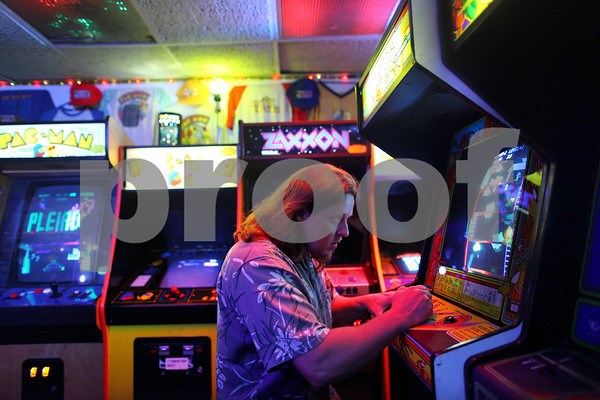 Beck Diefenbach  -  bdiefenbach@daily-chronicle.com<br /> <br /> Ken Gage, of Carie, Ill., gets into the zone as he plays Kangaroo at Star Worlds Arcade in DeKalb, Ill., on Tuesday Aug. 25, 2009.