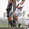 Beck Diefenbach  -  bdiefenbach@daily-chronicle.com<br /> <br /> Crystal Lake Central's Erin Frazier, left, (17) clashes with Sycamore's Nici Newquist (2) during the second half of the Belvidere Class 2A sectional semi-final game at Belvidere High School in Belvidere, Ill., on Wednesday May 27, 2009.