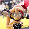 Beck Diefenbach  -  bdiefenbach@daily-chronicle.com<br /> <br /> Sycamore's Zach Spiewak, left, tries to flip Yorkville's Mike Soris during the 130 lbs match of the game at Sycamore, Ill., on Thursday Dec. 3, 2009.