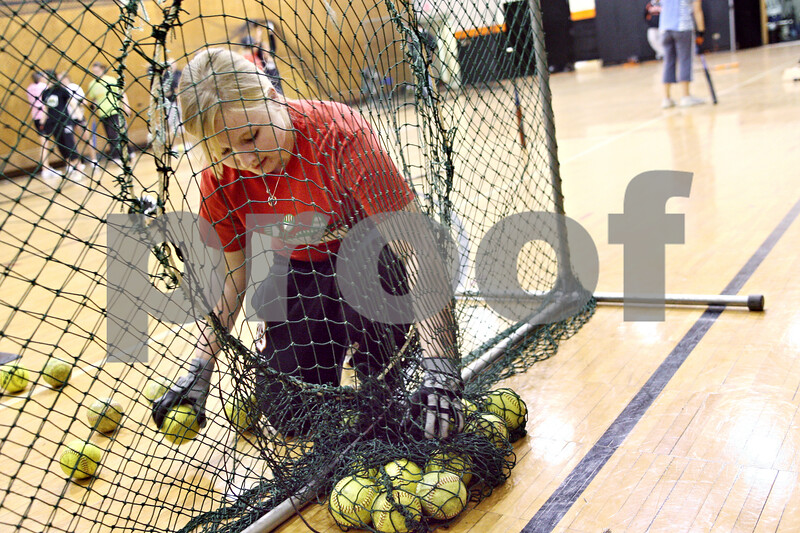 Beck Diefenbach  -  bdiefenbach@daily-chronicle.com<br /> <br /> DeKalb's Kristen Roenfanz picks up softball following a drill during practice at DeKalb High School in DeKalb, Ill., on Monday March 30, 2009.