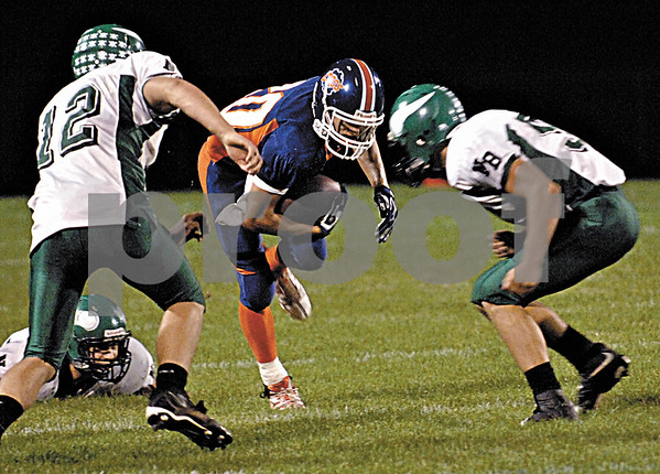 Genoa High School's Nick Lopez splits the North Boone defense (Alex Albrecht, left, and Jake Simmons during 2nd quarter action on Friday, September 18, 2009 in Genoa.(Marcelle Bright/for the Chronicle)
