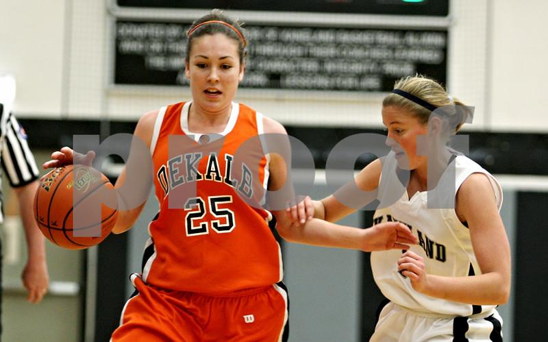 Rob Winner – rwinner@daily-chronicle.com<br /> Rob Winner – rwinner@kcchronicle.com<br /> DeKalb's Shelby Wood (left) moves the ball past Kaneland's Emily Heimerdinger during the first quarter.<br /> 12/04/2009