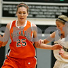 Rob Winner – rwinner@daily-chronicle.com<br /> Rob Winner – rwinner@kcchronicle.com<br /> DeKalb's Shelby Wood (left) moves the ball past Kaneland's Emily Heimerdinger during the first quarter.<br /> 12/04/2009