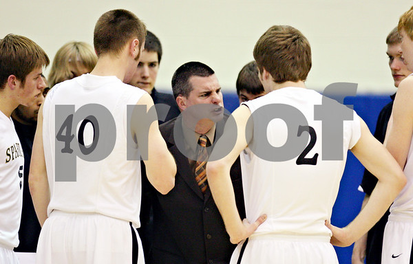 Beck Diefenbach – bdiefenbach@daily-chronicle.com<br /> <br /> Sycamore's head Coach Jeff Hillmer talks with his players during a timeout in the second quarter of the regional semi-final game at Central High School in Burlington, Ill., on Monday March 2 , 2009.
