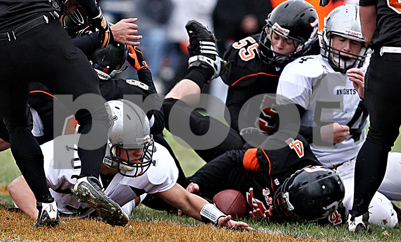 Rob Winner - rwinner@daily-chronicle.com<br /> <br /> DeKalb's Bobby Russell (4) is able to recover an onside kick to start off Saturday's game against Kaneland.<br /> <br /> 10/10/2009