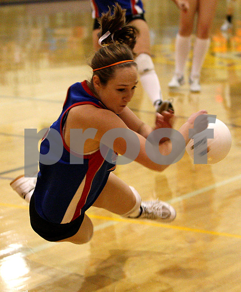 Rob Winner – rwinner@daily-chronicle.com<br /> Hinckley-Big Rock's Alyssa Baunach dives for a ball late in the second game during the Class 1A Serena Sectional final. Hinckley-Big Rock fell to Newark 24-26 and 17-25 to end their season.<br /> 11/05/2009