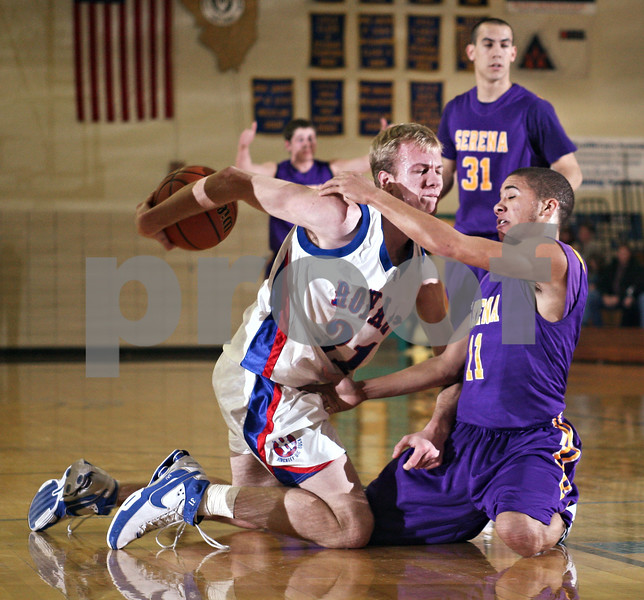 Beck Diefenbach  -  bdiefenbach@daily-chronicle.com<br /> <br />  Hinkley-Big Rock's Ryan Korth (31) attempts to keep the ball away from Serena's Blake Chapman (11) during the second quarter of the game of the first round of the Little Ten Conference Basketball Tournament at Somonauk High School in Somonauk, Ill., on Monday Feb. 2, 2009.