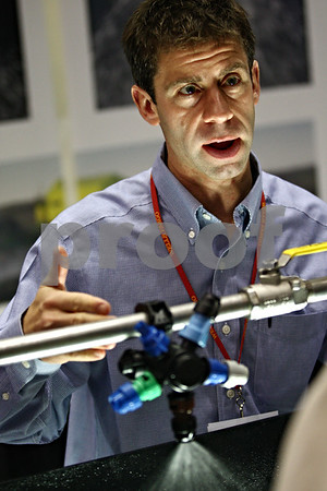 Beck Diefenbach  -  bdiefenbach@daily-chronicle.com<br /> <br /> Rob Gloe, of Green Leaf Technologies, demonstrates the efficiencies of the TDXL Turbo Drop spay nozzle during the 27th Annual Northern Illinois Farm Show at the Northern Illinois University Convocation Center in DeKalb, Ill., on Wednesday Jan. 7, 2009. This new spray nozzle reduces evaporation and off-target drift due to wind, allowing a savings of up to 20% on spray costs.